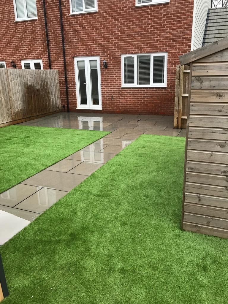 Sandstone patio and artificial grass in Ashford, Kent ...